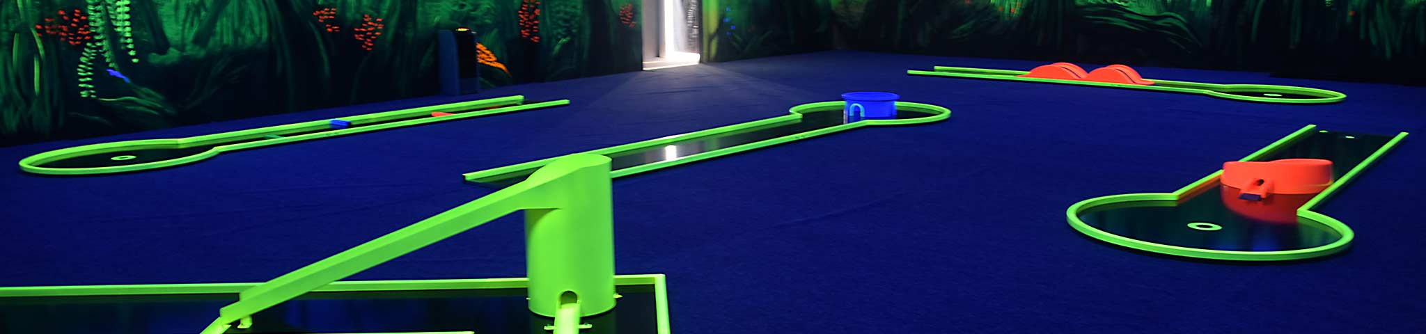 Glow in the Dark - Where Blacklight meets Mini Golf!